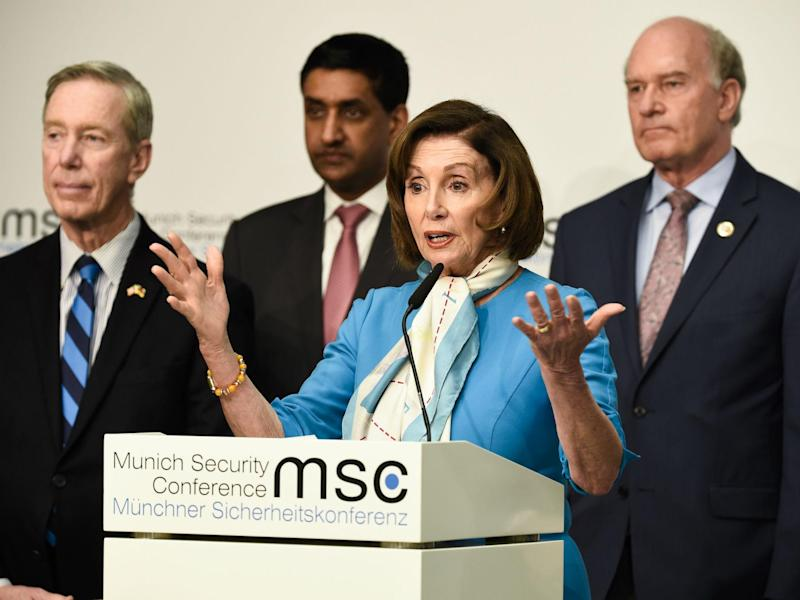 Nancy Pelosi, centre, was one of those to lament the lack of a UK minister in Munich