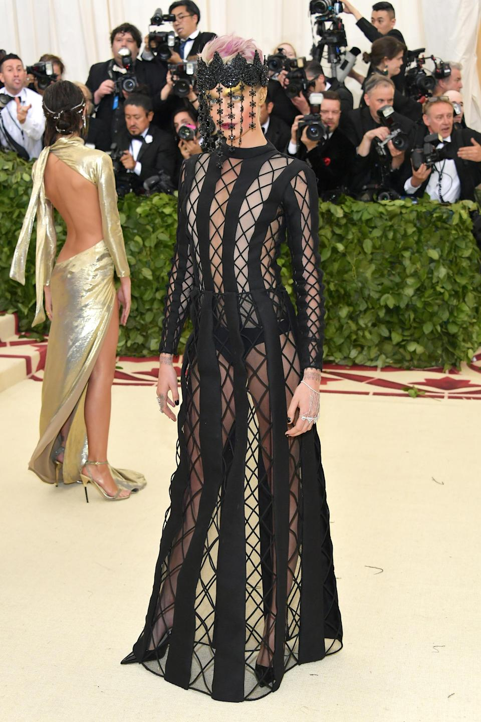 <p>Of course it wouldn't be a list of this year's most unusual celebrity looks without a Met Gala mention. With the opening of the 'Heavenly Bodies: Fashion and the Catholic Imagination' exhibition, Cara Delevingne chose a sheer Dior dress accessorised with a Marianna Harutunian crown. Her freshly-dyed pink 'do and gold shadow made the ensemble even more memorable. <em>[Photo: Getty]</em> </p>