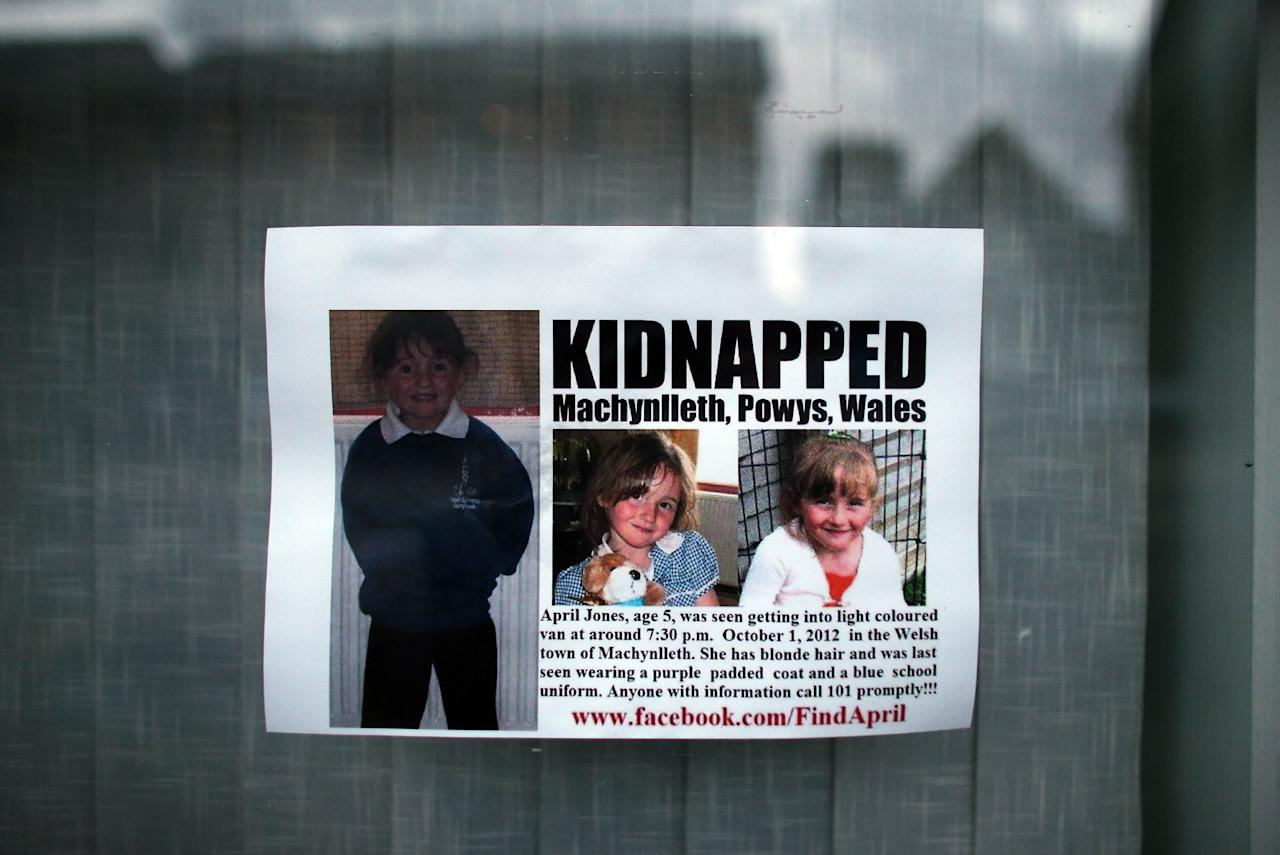 MACHYNLLETH, WALES - OCTOBER 03:  A poster is seen in a shop window for missing April Jones on October 3, 2012 in Machynlleth, Wales. April Jones, a five-year-old girl was abducted from outside her house on Monday night. Police have arrested 46-year-old Mark Bridger in connection with her disappearance in the Machynlleth area.  (Photo by Matt Cardy/Getty Images)
