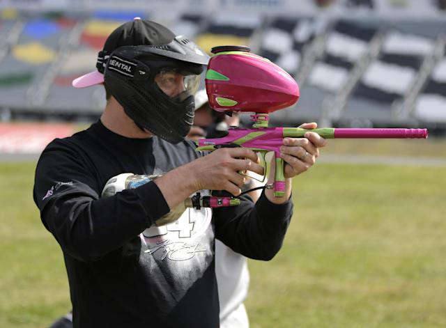 NASCAR driver Kyle Busch prepares for a paintball game against members of the media at Charlotte Motor Speedway in Concord, N.C., Tuesday, Sept. 24, 2013, promoting the upcoming Bank of America 500 NASCAR Sprint Cup auto race on Oct. 12, 2013. (AP Photo/Chuck Burton)