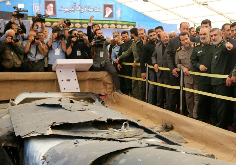 Iran has put what it says is the debris of a US drone it shot down over the Gulf in June on display in a special exbition in Tehran