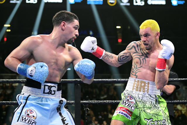 Ivan Redkach (R) and Danny Garcia exchange punches during their WBC silver world welterweight title eliminator at Barclays Center on Jan. 25, 2020 in New York City. (Steven Ryan/Getty Images)