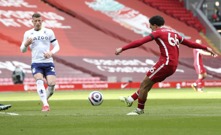 Liverpool's Trent Alexander-Arnold scores his side's second goal during the English Premier League soccer match between Liverpool and Aston Villa at Anfield stadium in Liverpool, England, Saturday, April 10, 2021. (Martin Rickett/Pool via AP)