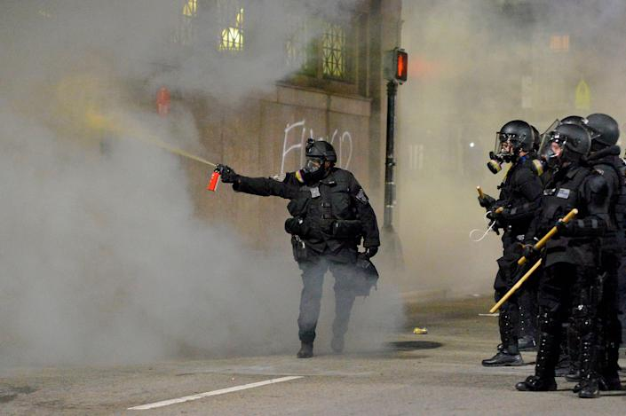 Police shoot pepper spray at a protester during a demonstration over the death of George Floyd, an unarmed black man who died in Minneapolis Police custody, in Boston, Massachusetts on May 31, 2020. JOSEPH PREZIOSO:AFP via Getty Images)