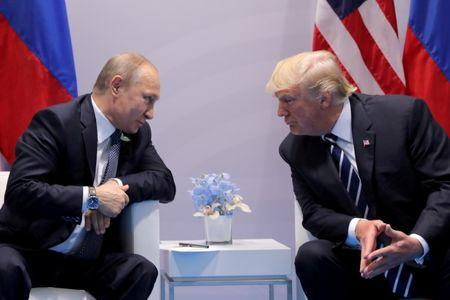 FILE PHOTO: Russia's President Putin talks to U.S. President Trump during their bilateral meeting at the G20 summit in Hamburg