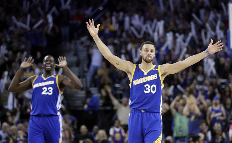 Are you not entertained by Stephen Curry and Draymond Green? (AP)