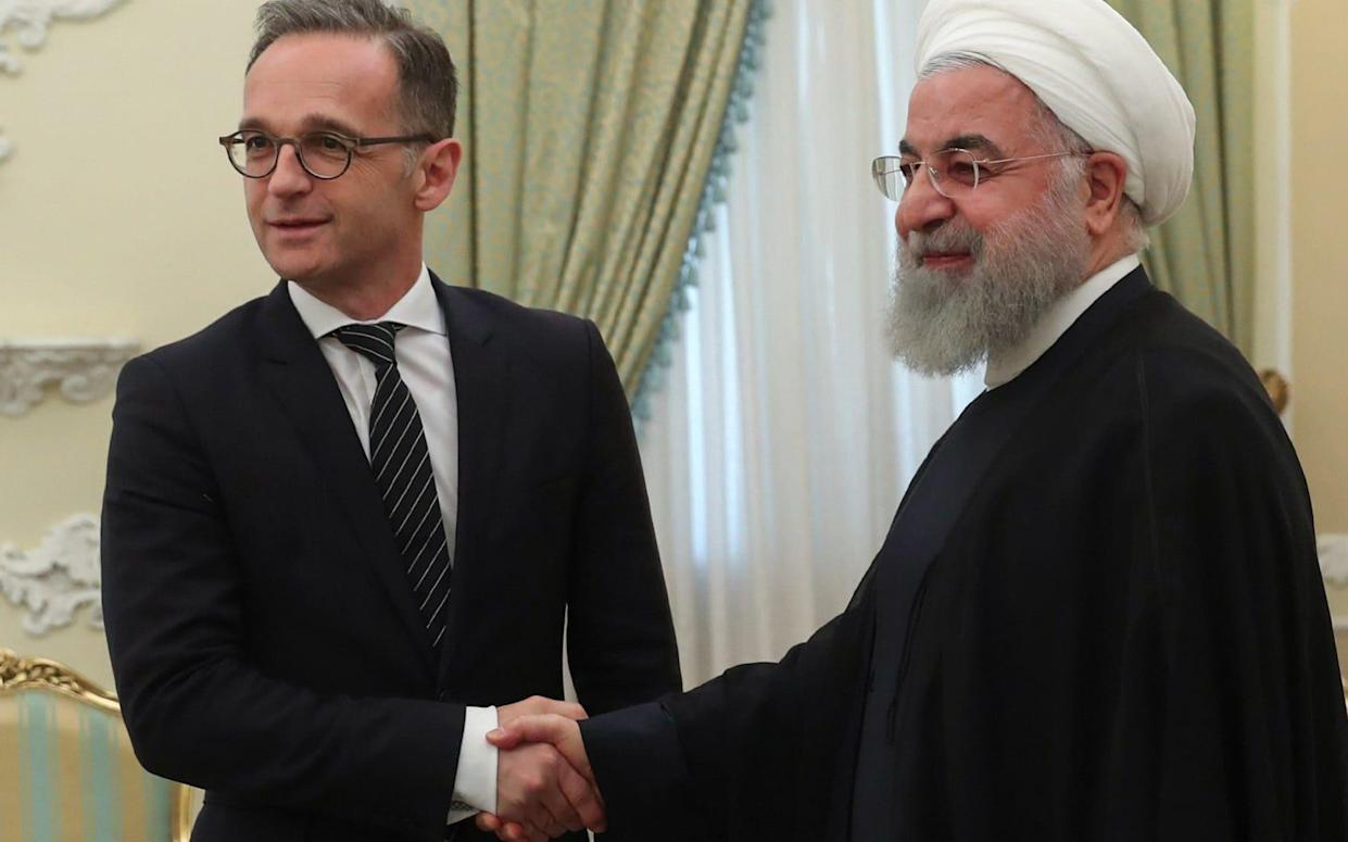 President Hassan Rouhani (R) shaking hands with German Foreign Minister Heiko Maas in the Iranian capital Tehran. - AFP