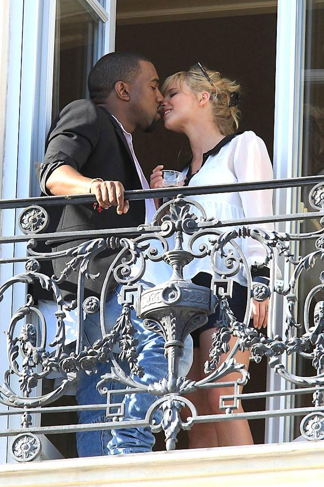 "Kanye West shared a smooch with a mystery woman from the balcony of his hotel on Sunday. Note to Kanye: Um, everyone can see you! But we guess that's the point ... <a href=""http://www.pacificcoastnews.com/"" target=""new"">PacificCoastNews.com</a> - May 15, 2011"