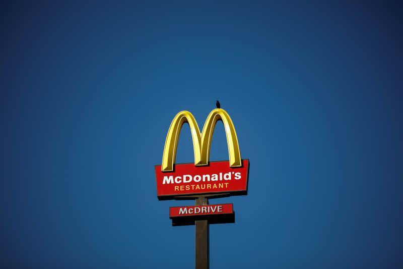 FILE PHOTO: The McDonald's company logo stands on a sign outside a restaurant in Bretigny-sur-Orge, near Paris
