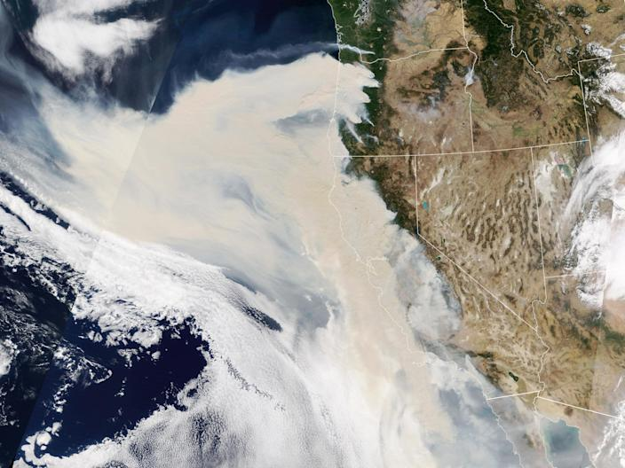 Thick smoke streams from intense fires in Oregon and California on Sept. 9. The smoke was so thick and widespread that it was easily visible 1 million miles away from Earth. (NASA Earth Observatory)