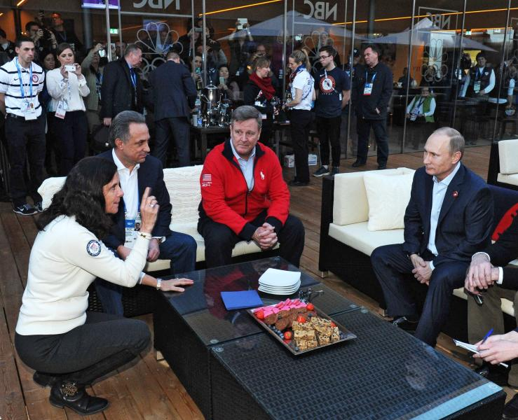 CORRECTS SPELLING TO BLACKMUN INSTEAD OF BLACKMAN- Russian President Vladimir Putin, right, visits USA House during the 2014 Winter Olympics, Friday, Feb. 14, 2014 in Sochi, Russia. From left, US Olympic Committee official Lisa Baird, Russian Sports Minister Vitaly Mutko and Head of the United States National Olympic Committee Scott Blackmun. (AP Photo/RIA-Novosti, Mikhail Klimentyev, Presidential Press Service)