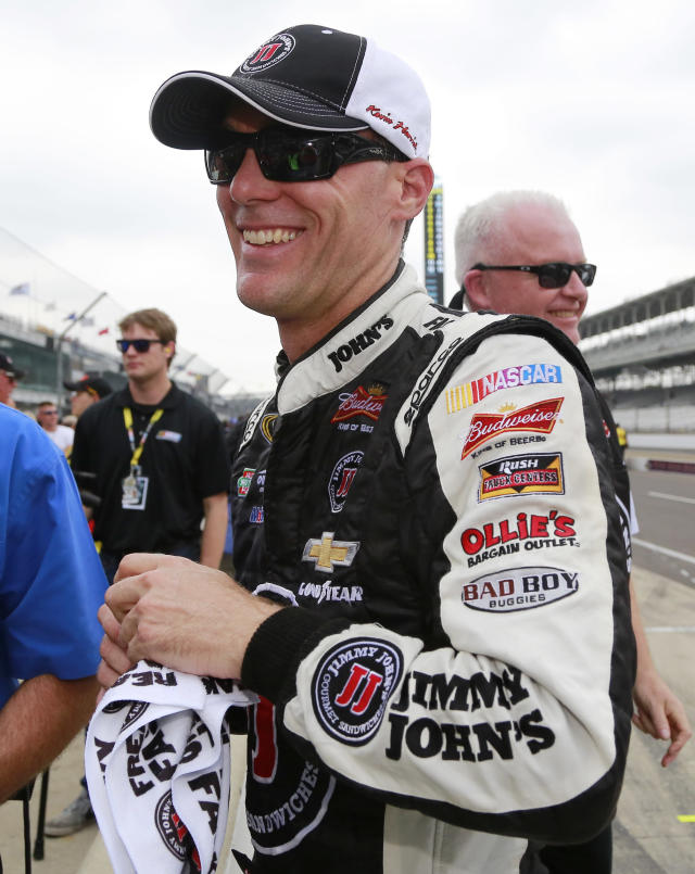 Kevin Harvick smiles after winning the pole for the Brickyard 400 auto race at the Indianapolis Motor Speedway in Indianapolis, Saturday, July 26, 2014. (AP Photo/R Brent Smith)