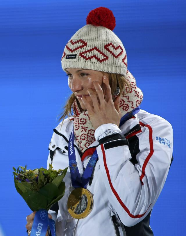 Gold medalist Anastasiya Kuzmina of Slovakia smiles during the medal ceremony for the women's biathlon 7.5km sprint event at the Sochi 2014 Winter Olympics February 10, 2014. REUTERS/Eric Gaillard (RUSSIA - Tags: OLYMPICS SPORT BIATHLON)