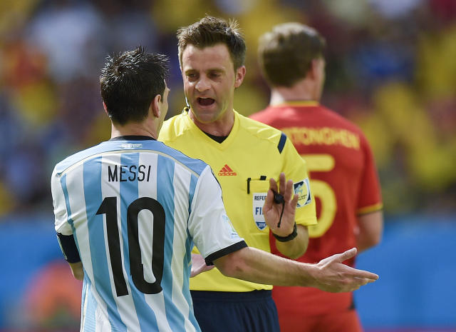 Referee Nicola Rizzoli of Italy speaks with Argentina's Lionel Messi during the World Cup quarterfinal soccer match between Argentina and Belgium at the Estadio Nacional in Brasilia, Brazil, Saturday, July 5, 2014. (AP Photo/Martin Meissner)