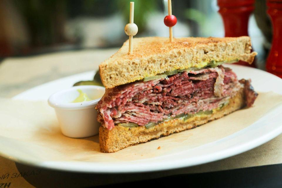 "<p><strong>Pastrami on Rye</strong></p><p>If you're a New Yorker, you know that Pastrami on Rye is the New York City staple. Stacked high enough where the sandwich doesn't fit in your mouth years after years it remains just as in-demand. <a href=""https://katzsdelicatessen.com/"" rel=""nofollow noopener"" target=""_blank"" data-ylk=""slk:Katz's Delicatessen"" class=""link rapid-noclick-resp"">Katz's Delicatessen</a> in the East Village is the most popular location, and their sandwich does not disappoint. </p>"