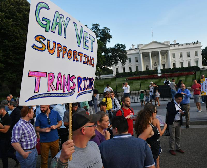 Protesters gather in front of the White House after Donald Trump announces his ban on transgender troops: PAUL J. RICHARDS/AFP/Getty Images
