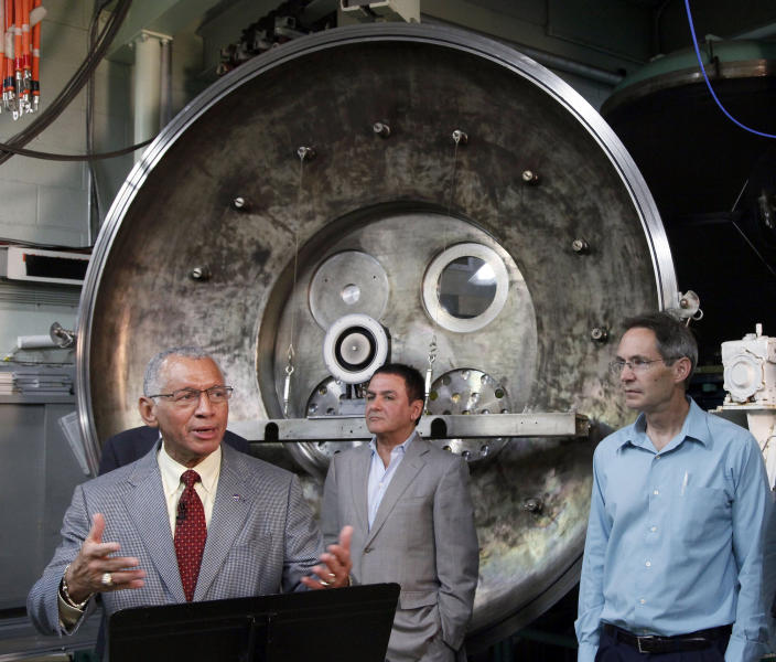 NASA Administrator Charles Bolden, left to right, Firouz Naderi, Director for the Solar System Exploration, and John Brophy, Electric Propulsion Engineer, are shown during Bolden's visit to the Jet Propulsion Laboratory in Pasadena, Calif., on Thursday, May 23, 2013. NASA engineers are developing an ion engine for an asteroid capture mission later this decade. (AP Photo/Nick Ut)