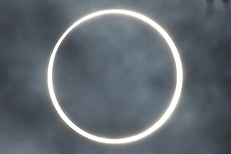 """The moon totally covers the sun in the rare """"ring of fire"""" solar eclipse as seen from the south Indian city of Dindigul in Tamil Nadu state (AFP Photo/Arun SANKAR                     )"""