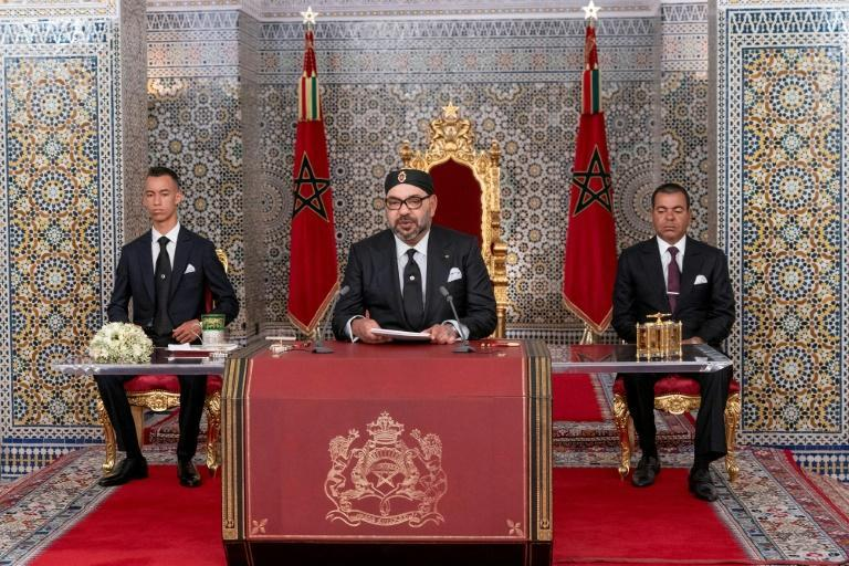 Despite the change of guard, policy shifts are unlikely since major decisions in Morocco still come from King Mohammed VI (C) (AFP/-)