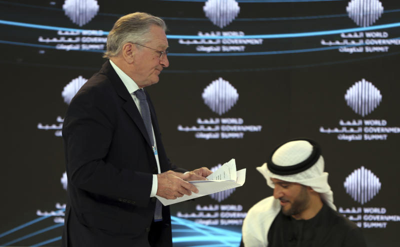 "American Hollywood star Robert De Niro, returns to his seat after his speech during the World Government Summit in Dubai, United Arab Emirates, Sunday, Feb. 11, 2018. De Niro took aim at the Trump administration's stance on climate change, telling a packed audience that he was visiting from a ""backward"" country suffering from ""temporary insanity."" (AP Photo/Kamran Jebreili)"