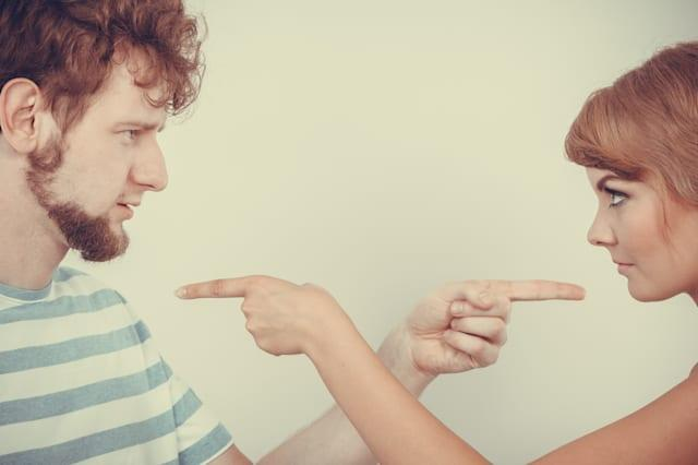 Conflict bad relationships concept. Two people couple pointing fingers at each other