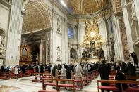 Pope Francis celebrates the Easter Vigil in a near empty St. Peter's Basilica, at the Vatican