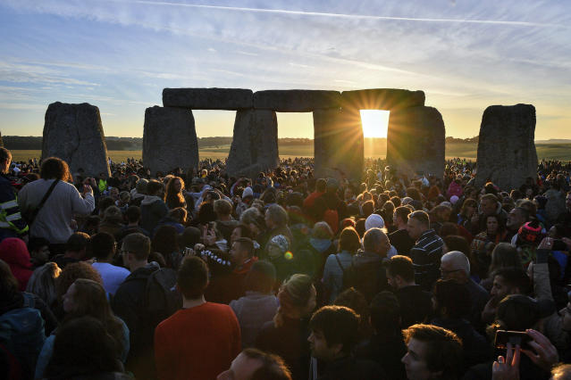 Crowds of people gather at Stonehenge to celebrate the dawn of the longest day in the UK in 2018. (Getty)