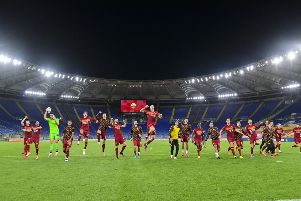 Roma players celebrate their victory at the end of an Italian Serie A soccer match between Roma and Lazio, at Rome's Olympic Stadium, Saturday, May 15, 2021. Roma won 2:0. (Fabio Rossi/LaPresse via AP)