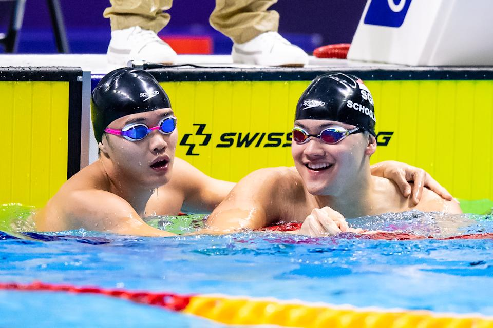 Singapore swimmer Teong Tzen Wei (left) being congratulated by compatriot Joseph Schooling after he won the men's 50m butterfly final ahead of the Olympic champion. (PHOTO: SNOC/Andy Chua)