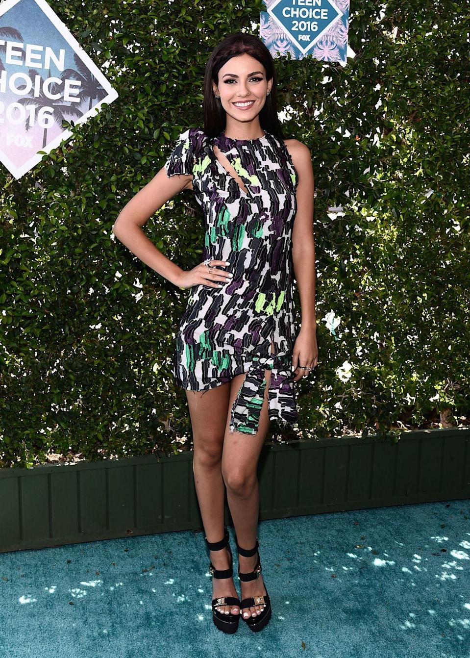 <p>Host of the night Victoria Justice stunned in a mixed-print Versace outfit. <i>[Photo: Rex]</i></p>