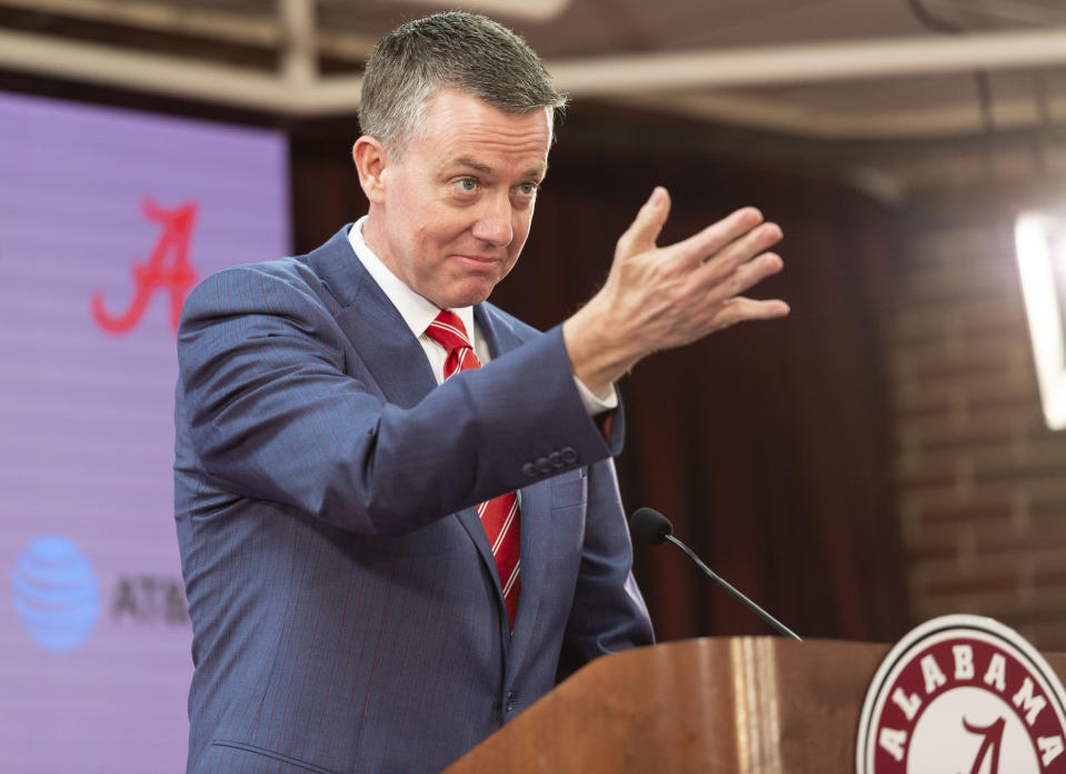 Alabama athletic director Greg Byrne gestures as he introduces Nate Oats as the new basketball coach for the University of Alabama, Thursday, March 28, 2019, in Tuscaloosa, Ala. (AP Photo/Vasha Hunt)