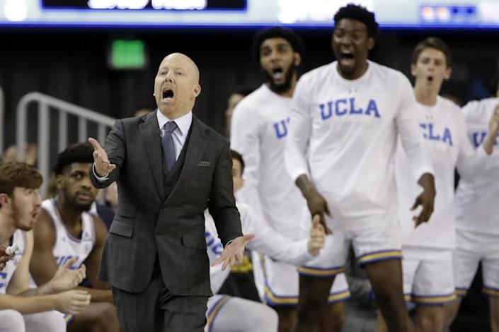 """UCLA coach Mick Cronin argues a call during a game against Washington State on Feb. 13. Cronin and his players met in person Tuesday for the first time since their season ended prematurely in March because of the coronavirus crisis. <span class=""""copyright"""">(Marcio Jose Sanchez / Associated Press)</span>"""