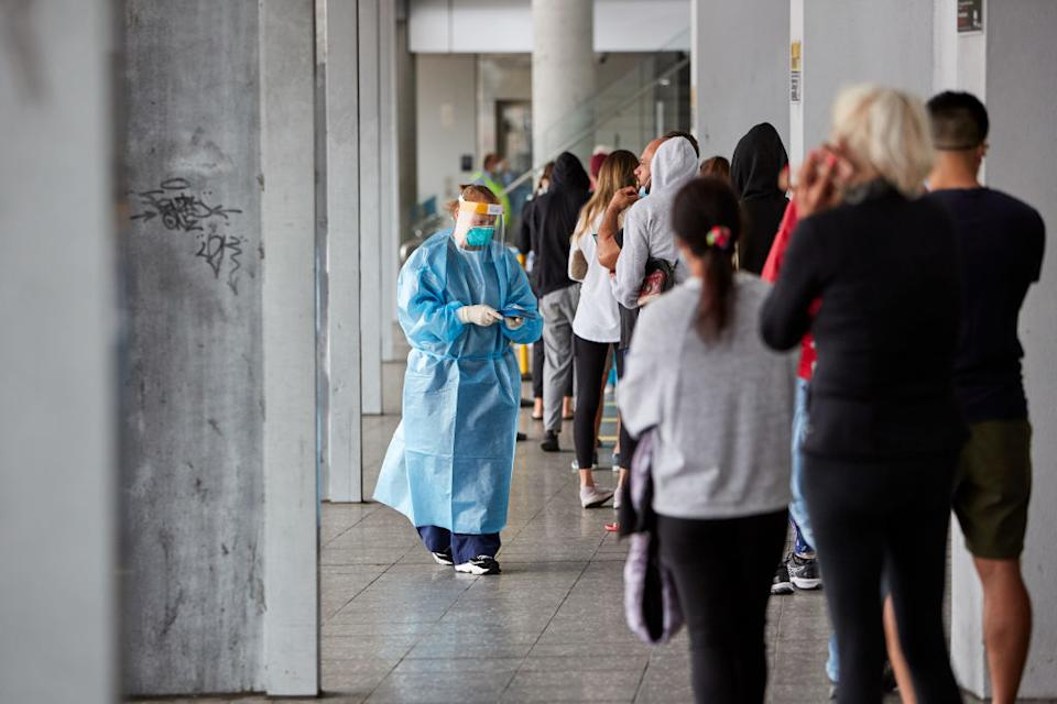 People are seen waiting in long lines for Covid-19 tests at the Brookvale Centre in Sydney, Australia.