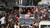 """Presidential candidate Rodrigo """"Digong"""" Duterte throws an election souvenir shirt to supporters during election campaigning for May 2016 national elections in Malabon, Metro Manila in the Philippines April 27, 2016. REUTERS/Erik De Castro"""