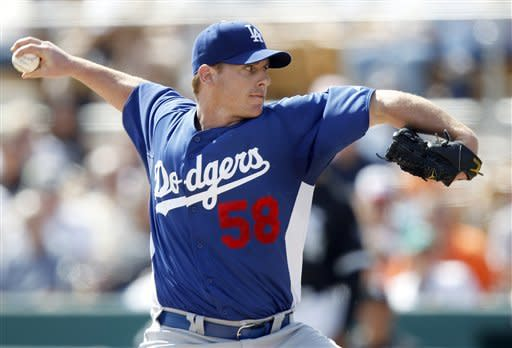 Los Angeles Dodgers' Chad Billingsley delivers a pitch against the Chicago White Sox in the first inning of a spring training baseball game Monday, March 5, 2012, in Glendale, Ariz. (AP Photo/Paul Connors)