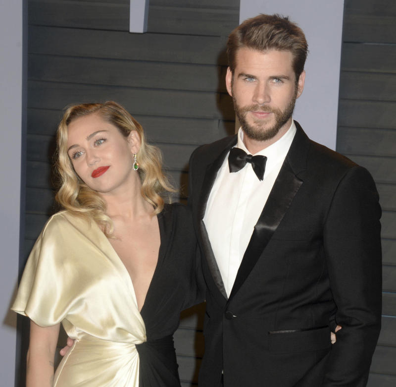 August 21st 2019 - Liam Hemsworth files for divorce from Miley Cyrus. - follow up to August 11th 2019 - Miley Cyrus and Liam Hemsworth have split up after less than one year of marriage. - File Photo by: zz/Dennis Van Tine/STAR MAX/IPx 2018 3/4/18 Miley Cyrus and Liam Hemsworth at The 2018 Vanity Fair Oscar Party in Beverly Hills, CA.