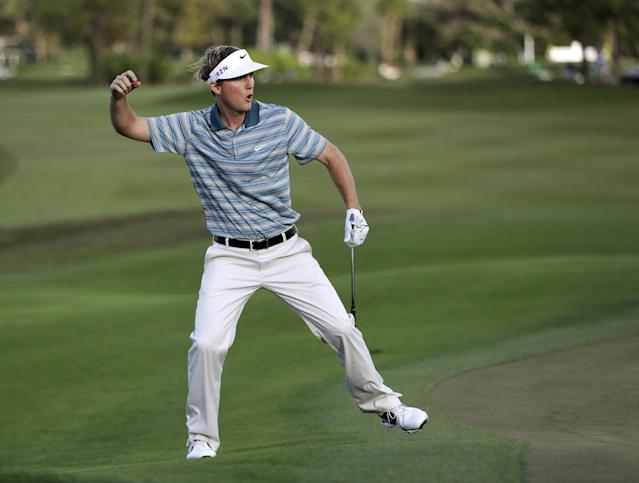 Russell Henley celebrates as he tied for the lead by chipping in for birdie on the 14th hole during the final round of the Honda Classic golf tournament, Sunday, March 2, 2014, in Palm Beach Gardens, Fla. Henley won the tournament after a four-man playoff. (AP Photo/Wilfredo Lee)