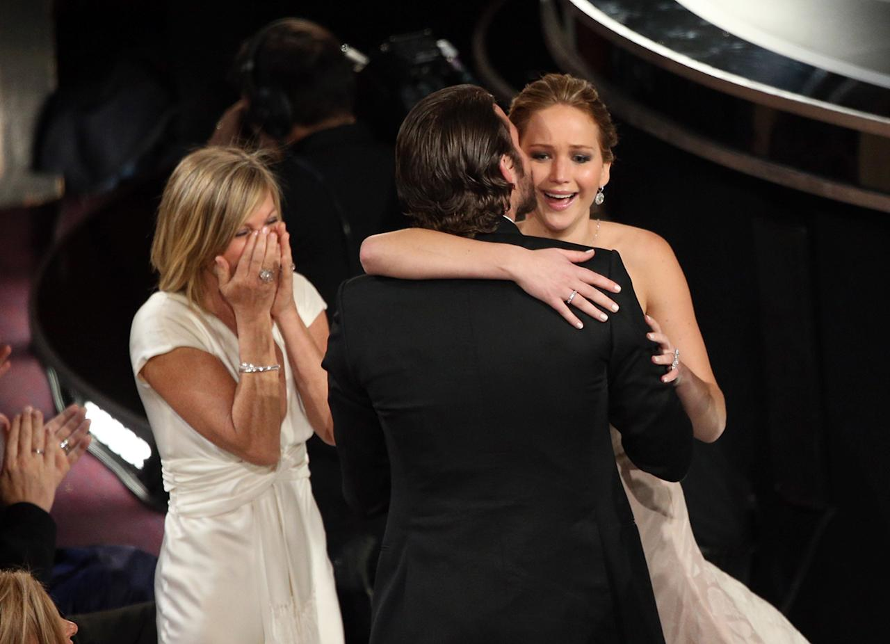 Jennifer Lawrence, mother Karen Lawrence and actor Bradley Cooper celebrate after Lawrence wins the Best Actress award for 'Silver Linings Playbook' onstage during the Oscars held at the Dolby Theatre on February 24, 2013 in Hollywood, California. (Photo by Mark Davis/WireImage)