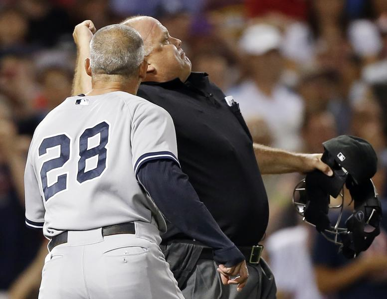 Home plate umpire Brian O'Nora, right, ejects New York Yankees manager Joe Girardi (28) in the second inning of a baseball game in Boston, Sunday, Aug. 18, 2013. (AP Photo/Michael Dwyer)