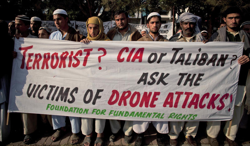 In this Friday, Dec. 10, 2010 file photo, Pakistani tribal villagers hold a rally to condemn U. S. drone attacks on their villages in border areas along the Afghanistan border, in Islamabad, Pakistan. The head of a U.N. team investigating casualties from U.S. drone strikes in Pakistan declared  on Friday, after a secret research trip to the country, that the attacks violate Pakistan's sovereignty. (AP Photo/B.K. Bangash)