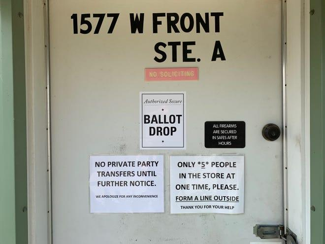 """On Monday, a sign at Selma's Central Valley Guns in Fresno County claims to be an """"Authorized Secure Ballot Drop."""" The Secretary of State's office issued a memo to county registrars this weekend clarifying that unofficial drop boxes are illegal and ballots must be returned by mail or to official polling places, vote centers, or ballot drop-off locations."""