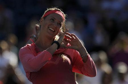Victoria Azarenka of Belarus makes a heart symbol as she celebrates defeating Flavia Pennetta of Italy at the U.S. Open tennis championships in New York September 6, 2013. REUTERS/Eduardo Munoz