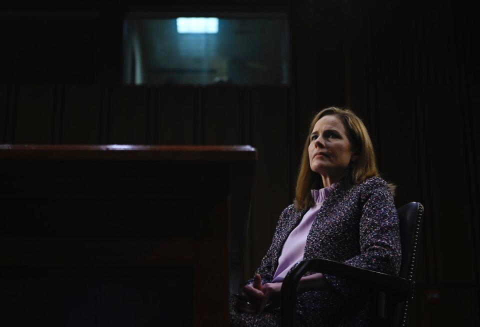 "<span class=""caption"">Amy Coney Barrett testifies before the Senate.</span> <span class=""attribution""><a class=""link rapid-noclick-resp"" href=""https://www.gettyimages.com/detail/news-photo/supreme-court-nominee-judge-amy-coney-barrett-testifies-news-photo/1229075569?adppopup=true"" rel=""nofollow noopener"" target=""_blank"" data-ylk=""slk:Andrew Caballero-Reynolds Pool/Getty Images"">Andrew Caballero-Reynolds Pool/Getty Images</a></span>"