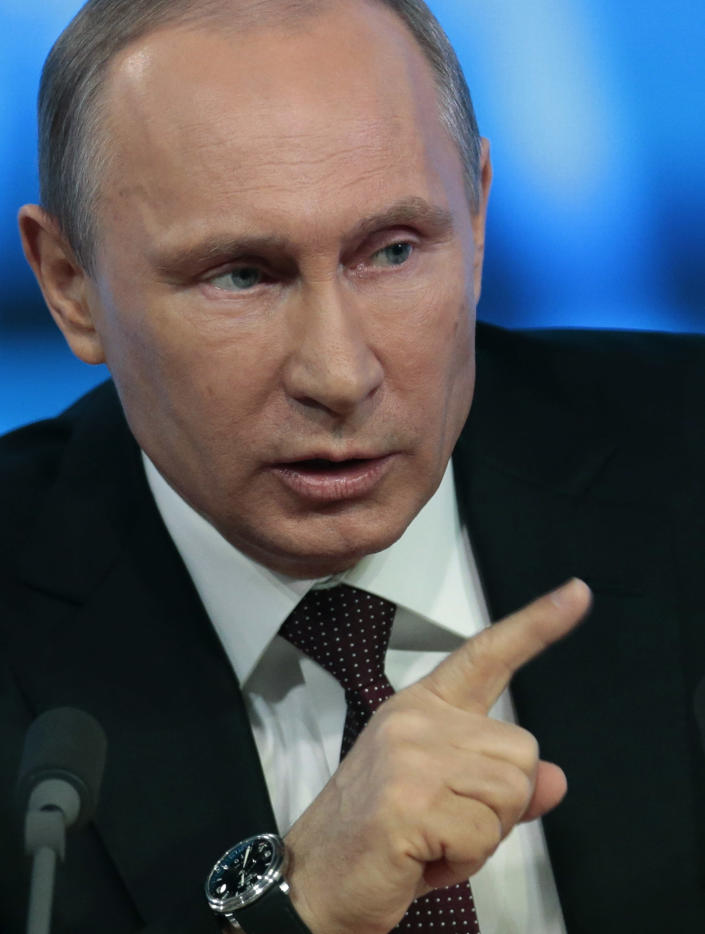 Russian President Vladimir Putin speaks at his annual news conference in Moscow, Russia, Thursday, Dec. 19, 2013. Putin said that Russia hasn't deployed missiles to its westernmost Baltic exclave, but continues to see it as a possible way of countering the U.S.-led missile defense in Europe. (AP Photo/Ivan Sekretarev)