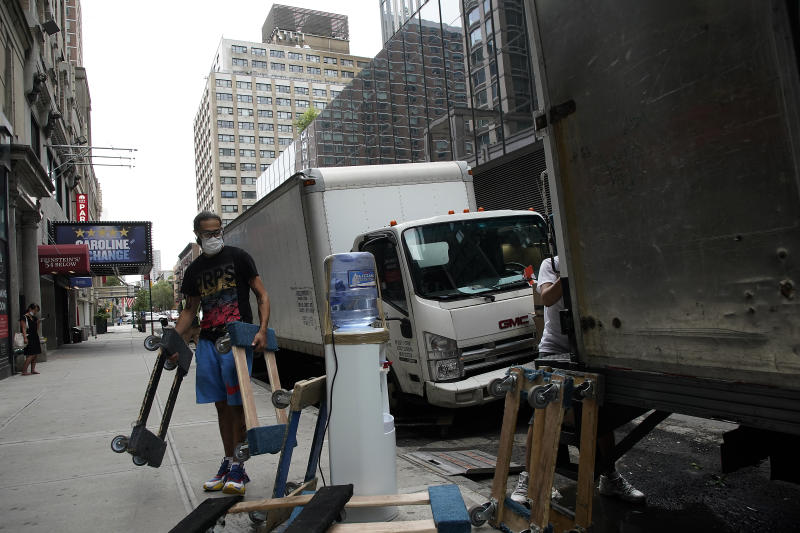 NEW YORK, NEW YORK - SEPTEMBER 02: Movers wearing protective masks unload a truck as the city continues Phase 4 of re-opening following restrictions imposed to slow the spread of coronavirus on September 2, 2020 in New York City. The fourth phase allows outdoor arts and entertainment, sporting events without fans and media production (Photo by John Lamparski/Getty Images)