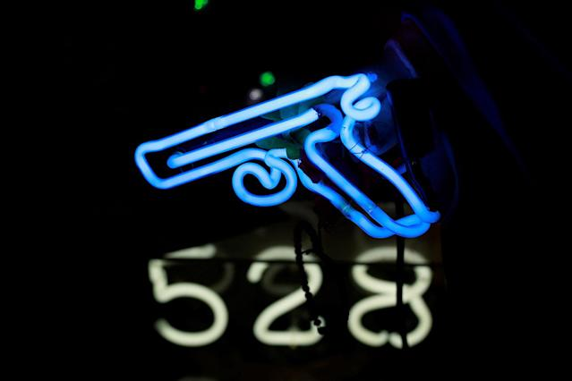 <p>A neon light in the shape of a gun forms part of an artwork exhibited in God's Own Junkyard gallery and cafe in London, Britain, May 13, 2017. (Photo: Russell Boyce/Reuters) </p>