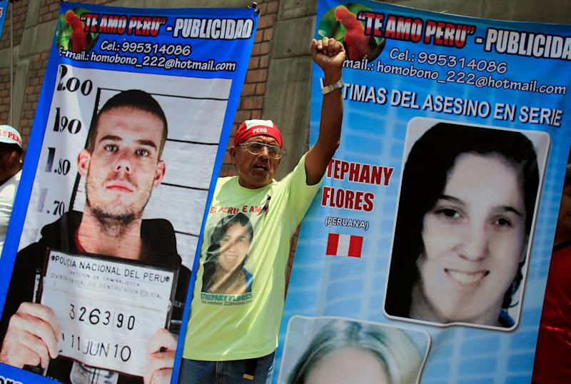 A man in Lima, Peru, holds posters of Dutch citizen Joran Van der Sloot and Peruvian girl Stephany Flores outside the Lurigancho prison, where van der Sloot was being read his sentence for murdering Flores in 2012. Van der Sloot was sentenced to 28 years in prison.