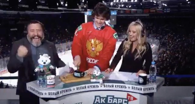 Dmitri Voronkov let some anger out on a piece of broadcast equipment that prevented a late two-man advantage for his team on Sunday. (Twitter//@CompleteHkyNews)