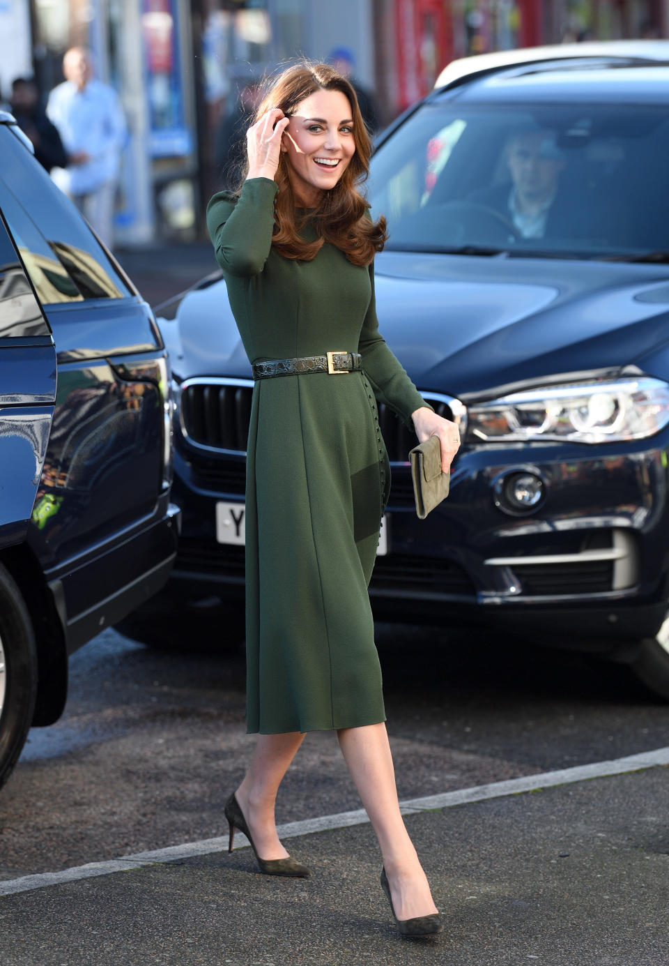 To visit Family Action's Lewisham base in South London, the mother-of-three wore a £550 Beulah dress with a matching £119 LK Bennett clutch and suede heels by Gianvito Rossi. [Photo: Getty]