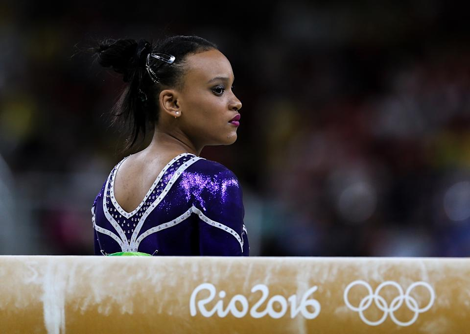 RIO DE JANEIRO, BRAZIL - AUGUST 11, 2016: Rebeca Andrade of Brazil performs her balance beam routine during the artistic gymnastics women's individual all-around final at the Rio 2016 Summer Olympic Games, at the Rio Olympic Arena. Valery Sharifulin/TASS (Photo by Valery Sharifulin\TASS via Getty Images)
